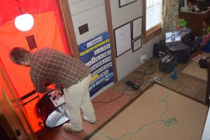 John Kidda, owner of reNew Home Inc., conducts a blower door test on the home of Blue Ridge Electric member Sean Dunlap.