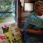 "Mary Ruble speaks at an Appalachian Voices event to present more than 1,000 signatures from Blue Ridge Electric members supporting access to ""on-bill"" financing"