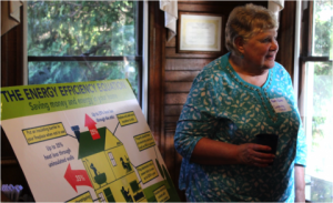 """Mary Ruble speaks at an Appalachian Voices event to present more than 1,000 signatures from Blue Ridge Electric members supporting access to """"on-bill"""" financing"""