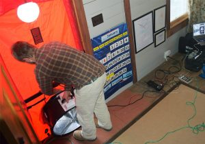 John Kidda, owner of reNew Home Inc , performs an energy audit as part of Appalachian Voices' home energy makeover contest in 2015.
