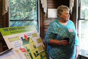 Mary Ruble, a Blue Ridge Electric member, discusses efficiency with stakeholders at a community meeting.