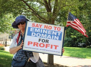 A participant in the July March on the Mansion. Photo courtesy of Chesapeake Climate Action Network