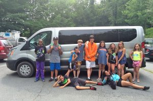 Campers with the Western Youth Network in Boone, N.C., pose with the organization's new vehicle, nicknamed the Spaceship. Photo courtesy Western Youth Network