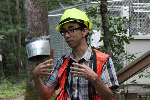 """Chris Oishi discusses his research in """"The Electric Forest"""" at the Coweeta Hydrologic Laboratory. Photo by Karl Bates"""