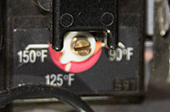 Slight turns of the dial adjust the tank's temperature.