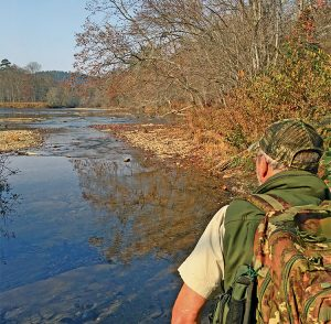 Lamar Marshall stands near the mouth of Brush Creek as he looks out over the Little Tennessee River. Photo by Kevin Ridder.