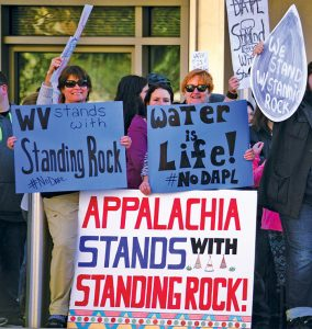 More than 200 people opposed to the pipeline rallied outside an Army Corps office in Huntington, W.Va. Photos by Chad Cordell