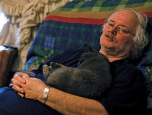When Ronald Wilmoth had his heat exhaustion episode, his cat wouldn't leave his side until the ambulance arrived.  Photo by Lou Murrey