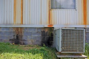 Rust stains indicate  water damage on the side of the Wilmoths' home. Photo by Lou Murrey