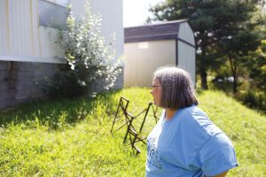 Left, Gerlene Wilmoth surveys the damage to the foundation of their home in Tazewell, Tenn. Photo by Lou Murrey.
