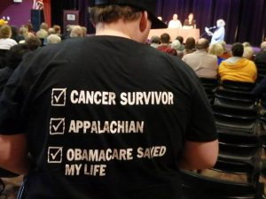 The back of forum attendee Matt Skeens' t-shirt has a clear message. Photo by Maxine Kinney