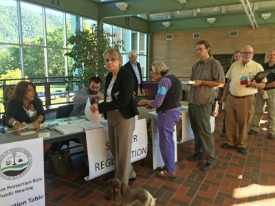 Citizens sign up to speak at a public hearing on the Stream Protection Rule in Big Stone Gap, Va., where clean water advocates argued for stronger protections and coal industry representatives relied on deception to rally against the rule.
