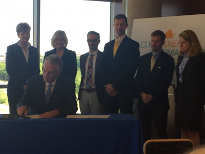 Gov. McAuliffe signs Executive Directive 11 with clean energy advocates. Photo by Mary Rafferty.