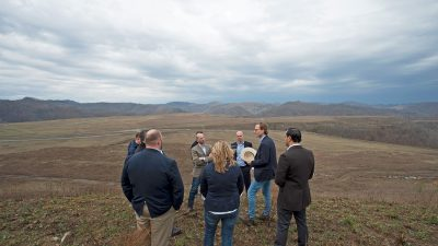 Jonathan Webb talks to group at site of former mine
