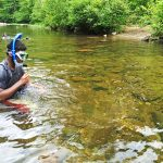 Boy snorkeling in Conasauga River