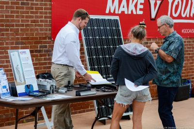 Attendees at the 2017 Southwest Virginia Solar Fair discuss about solar panels .