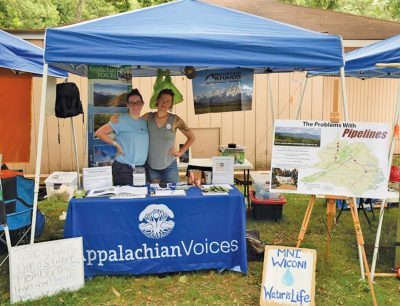 This summer, Max Rooke, left, and Lara Mack of our Virginia team shared news and resources about the fight against proposed pipelines at events across the state.