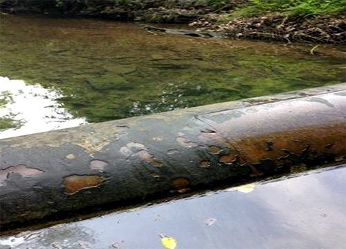 A closer look at an eroding pipe crossing a stream in middle Tennessee.