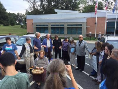Pastor Paul Wilson of Buckingham County leads a prayer circle before a supervisor meeting on the proposed Atlantic Coast Pipeline