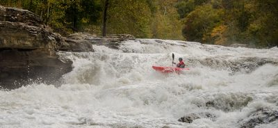 Kayaker in the rapids.