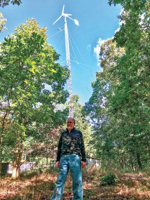 Roger Beale In Front of His Wind Turbine