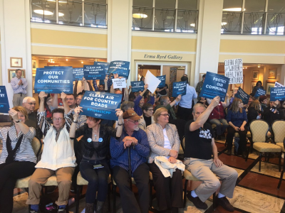 People holding signs at the Sierra Club's Hearing for Healthy Communities