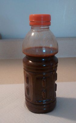 Plastic bottle with rust-colored tap water