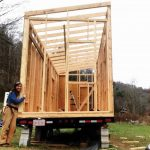 Sarah Kellogg with her tiny house frame