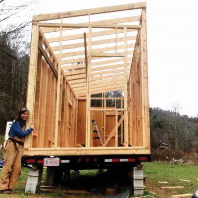 Sarah Kellogg with her tiny house frame