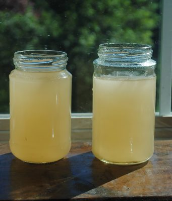 Mason jars with yellow tap water