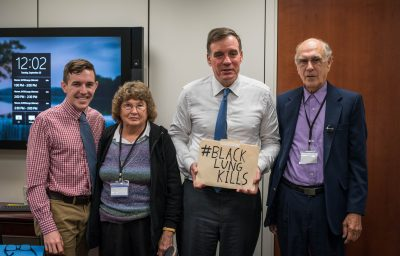 Big Stone Gap councilman Tyler Hughes, Peggy Brock from the SWVA chapter of the Black Lung Association and Bethel Brock, president of the SWVA chapter of the Black Lung Association and a former miner living with complicated black lung disease, met with Senator Mark Warner (second from left) to hand-deliver four local resolutions of support for extending the Black Lung Trust Fund.