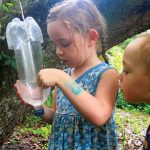 kid holding beetle trap
