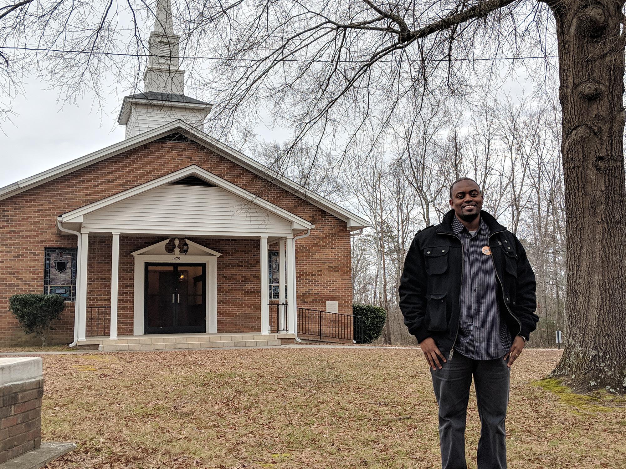 man by church