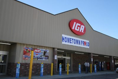 IGA store with sign reading Hometown Proud