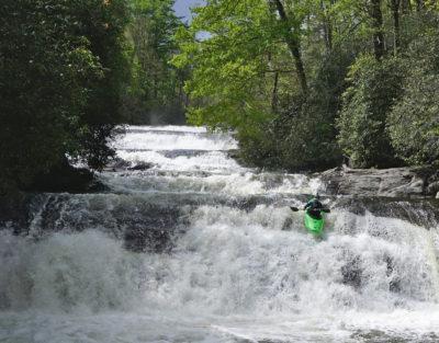 kayak runs waterfall