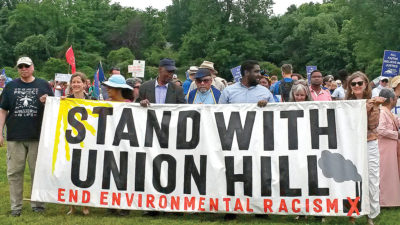 "Protestors hold banner that reads, ""Stand with union hill"""