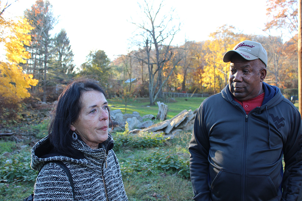 Environmental activist and town citizen stand and talk together