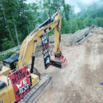 Protest banners hanging on pipeline equipment