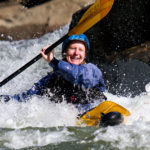 Chrissy paddles through whitewater