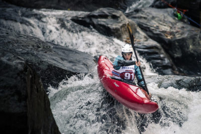 Emily paddles down a rapid