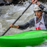 Kayaker paddles through rapid
