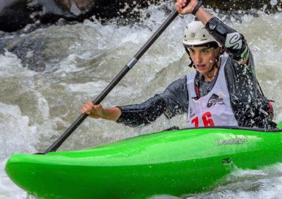 Kayaker paddles through rapid