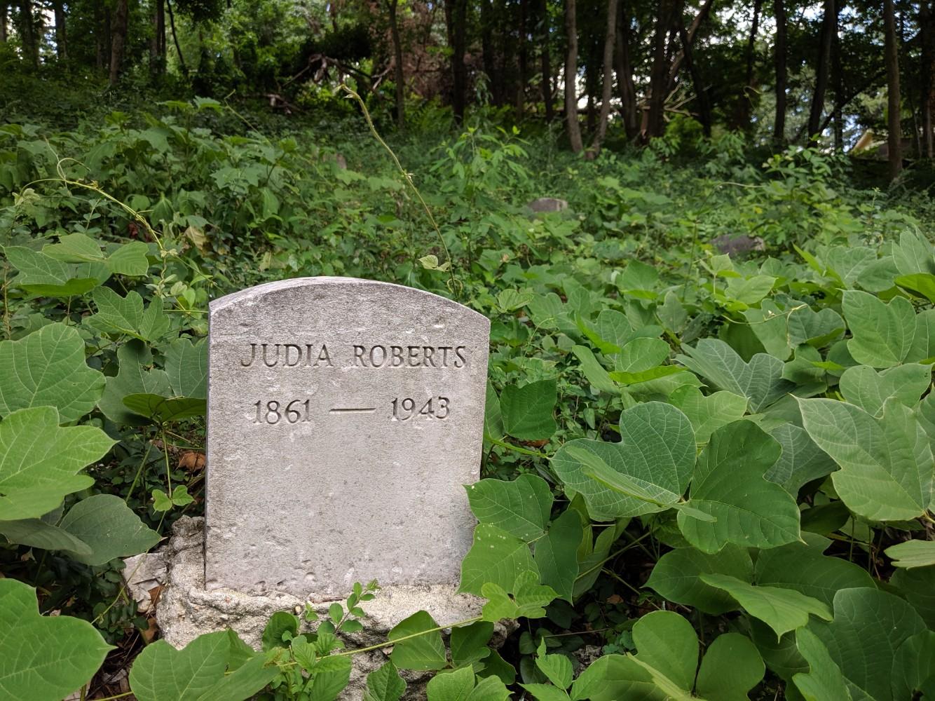 overgrown grave marker