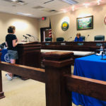 woman testifies at public hearing