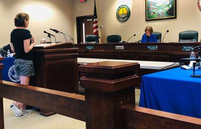 woman testifies at public hearing