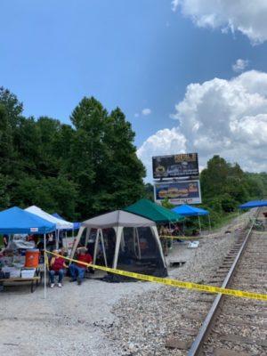 tents near train tracks