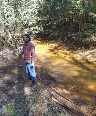 Matt with water sample near Copperas Fork