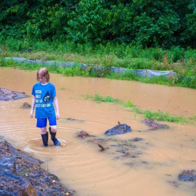 child in muddy water