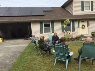 people by solar panels