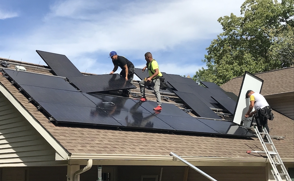 people installing solar